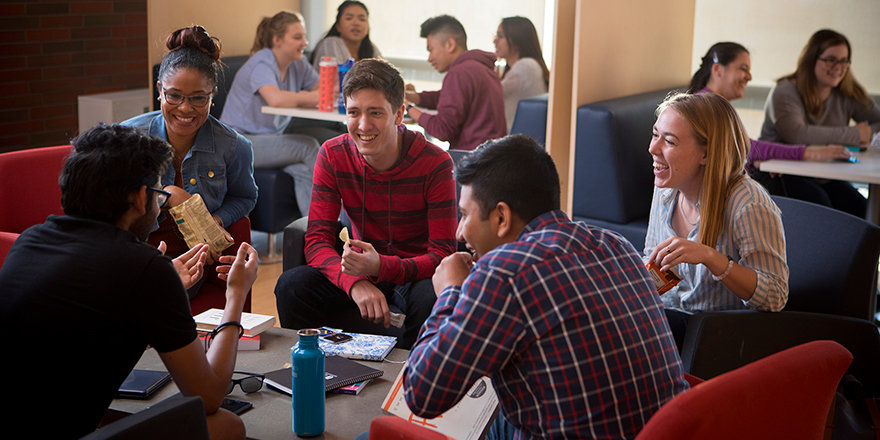 A group of joyful Ontario Tech University students indulge in some social time as part of a balanced day.
