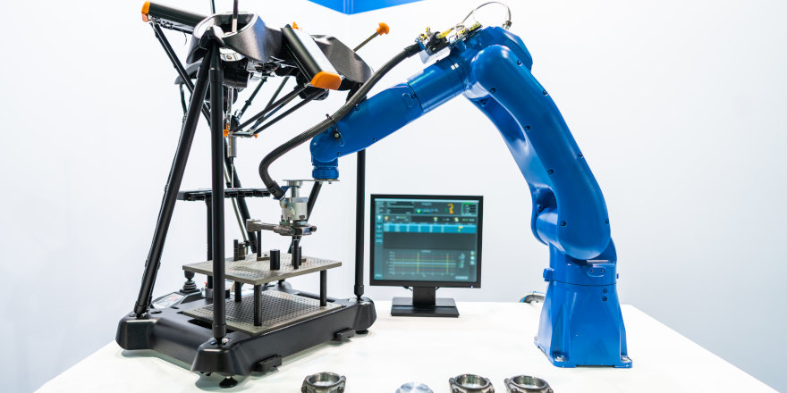 A robotic arm in a clean room works its magic upon a complex apparatus.