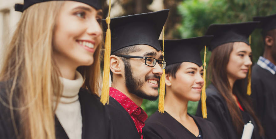 A lineup of happy students on graduation day.