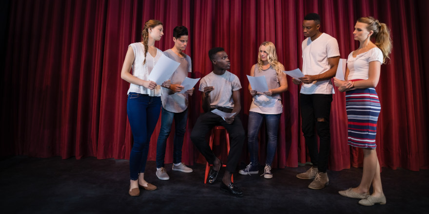 Canadore grads warm up for the play Shakespeare in Hollywood..
