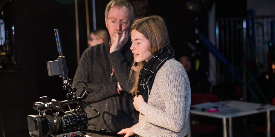 A University of South Wales student learns to use a camera as part of her training to work in a creative industry.