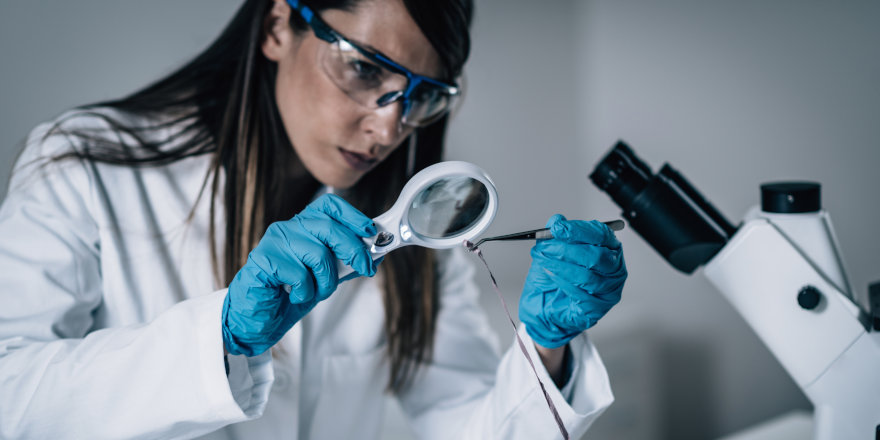 A forensic scientist, having studied in Canada, investigates and analyzes evidence from a crime scene using her knowledge of forensic science.