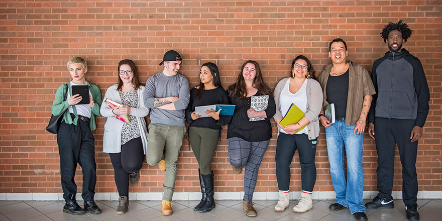 A group of satisfied Canadore College students and graduates enjoy the good news about the college's stats outpacing the province in many KPIs.