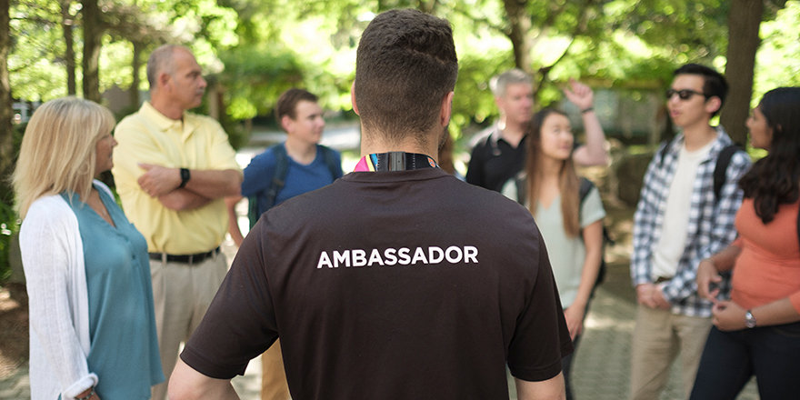 A University of Waterloo Ambassador helps a tour group out with his top tips for choosing a university.