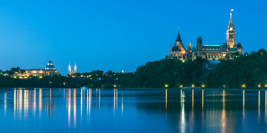 A spectacular late evening view of Parliament and the Ottawa River in Ontario.
