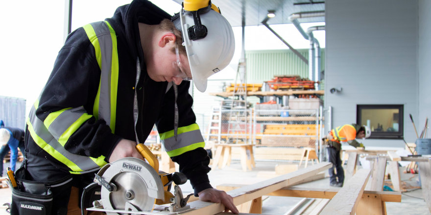 A skilled tradesperson works on a construction site thanks to the career training received at Vancouver Island University.