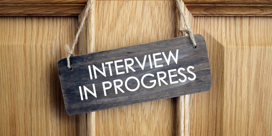 A hanging sign that reads 'Interview in Progress.'