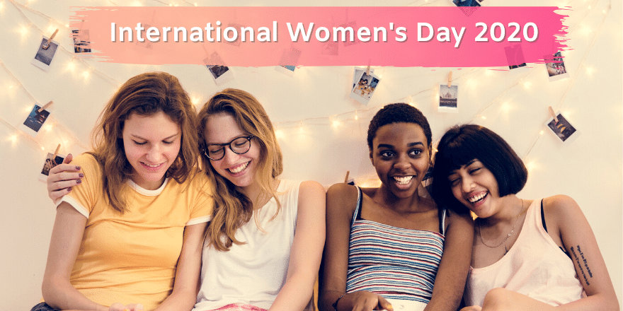 Four young women smile and laugh together on International Women's Day, 2020.