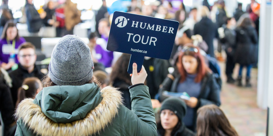 A first year student of Humber College guides a campus tour, and her participants, thanks to this survival guide, feel right at home!