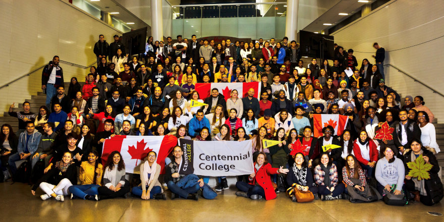 A huge array of student and staff members gather to welcome new international students to Centennial College.