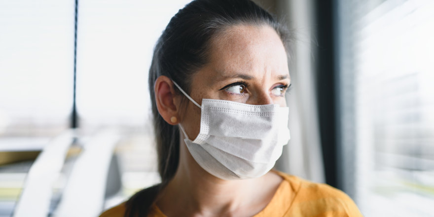 A woman in a face mask asks the question we're all wondering about: When will quarantine end in Canada?