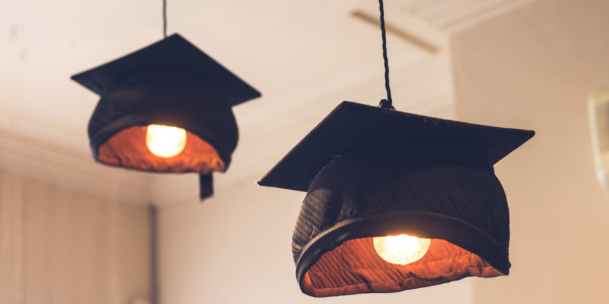 Mortar boards strung with lights hang at a polytechnic, like SAIT, near you!