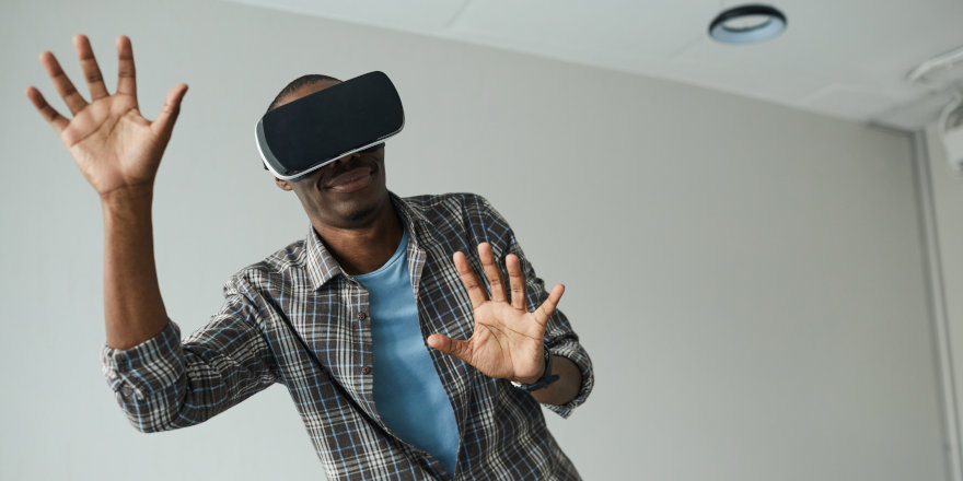 A man plays a video game in virtual reality developed at Middlesex University!